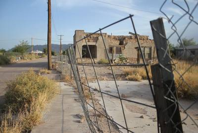 An adobe building near downtown Presidio is crumbling. The city is dotted with abandoned structures. Residences in the town often are not numbered by address, which causes problems for Emergency Medical Services, police and USPS.