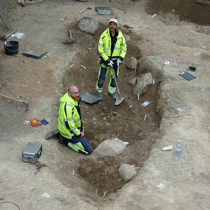 Osteologist Ola Magnell and archaeologist Anton Seiler excavating the boat grave