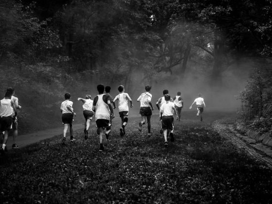 A boys track and field team in training at Franklin Park in Boston, MA.