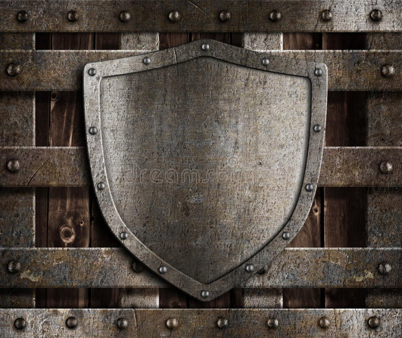 Aged Metal Shield On Wooden Medieval Gates Stock