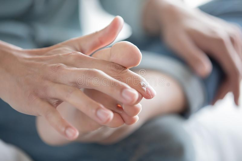 Applying Cream For Athletes Foot Stock Photo - Image of ...