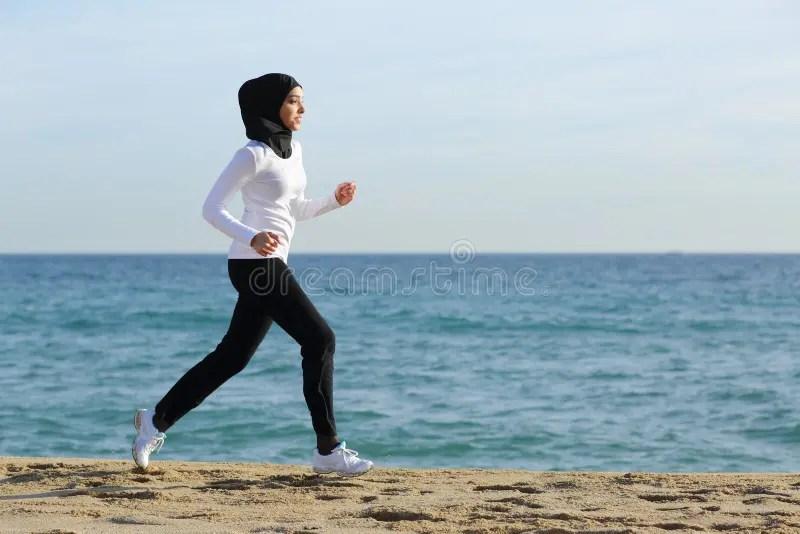 Arab Saudi Runner Woman Running On The Beach Royalty Free