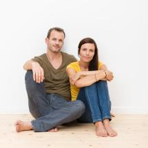 Attractive Young Couple Sitting Floor Royalty Free