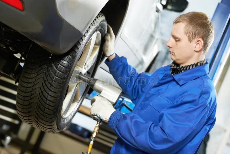 Auto Mechanic At Car Suspension Repair Work Stock Image