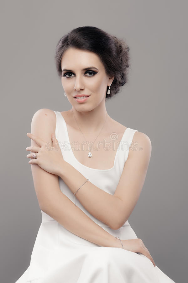 Beautiful Elegant Woman In White Dress Wearing Jewelry