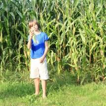 Little Boy Standing Barefoot