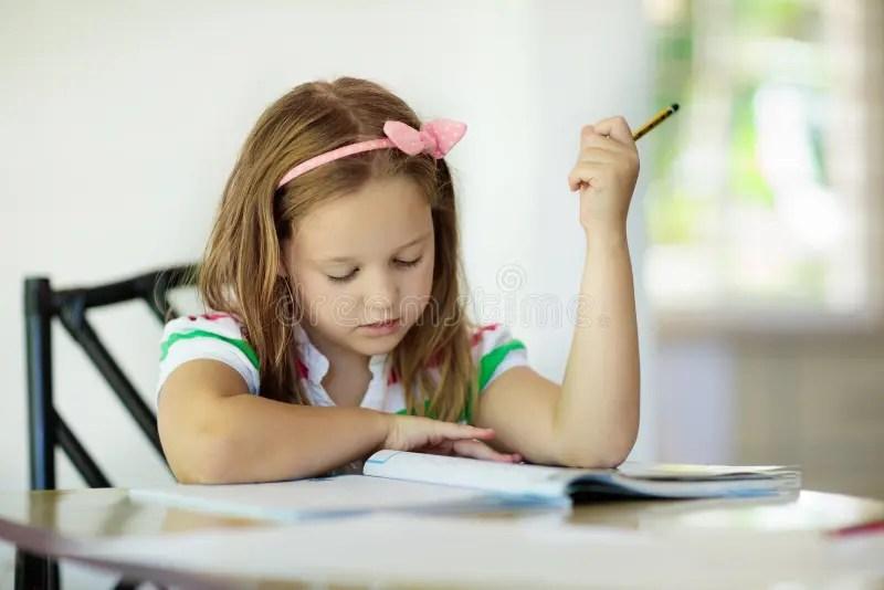 child doing homework for