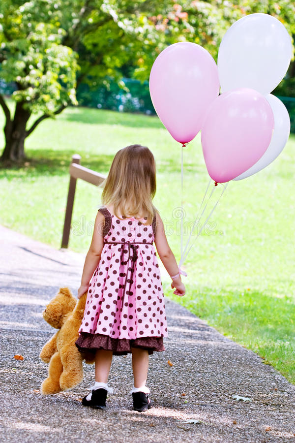Girl Holding Teddy Bear Wallpapers Child Dragging Teddy Bear And Holding Balloons Stock Photo