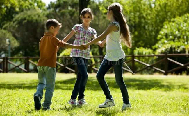 Children Playing Ring Around The Rosy Stock Photo Image