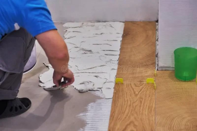 handyman placing tile spacer placing