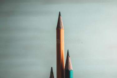 Colorful Pencils Lined Up Low Vertical On A Blurred