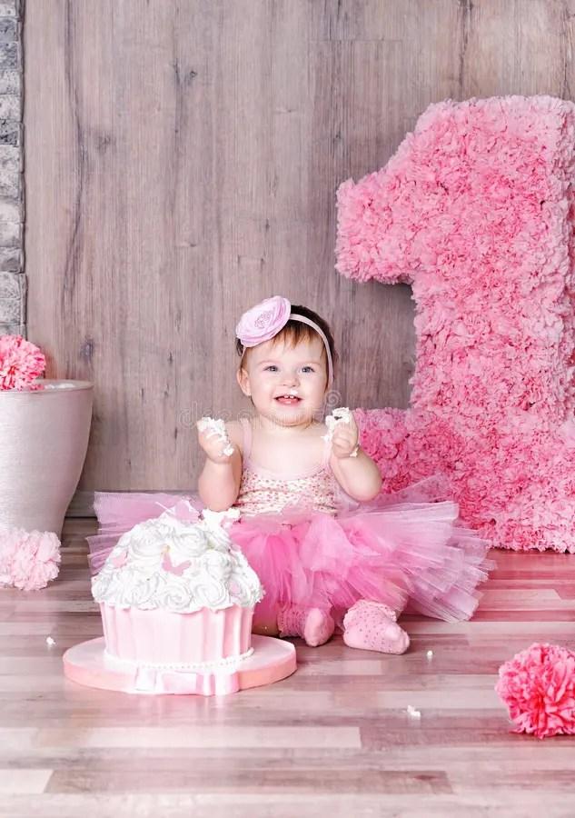 Cute Baby Girl Eating First Birthday Cake Stock Photo