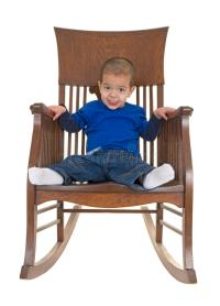 Cute Little Boy On Rocking Chair Stock Photo