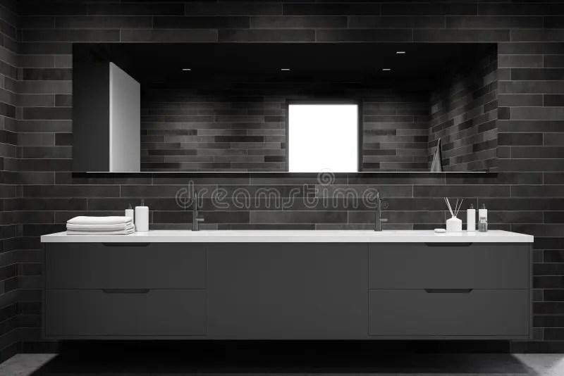 double sink in dark tile bathroom
