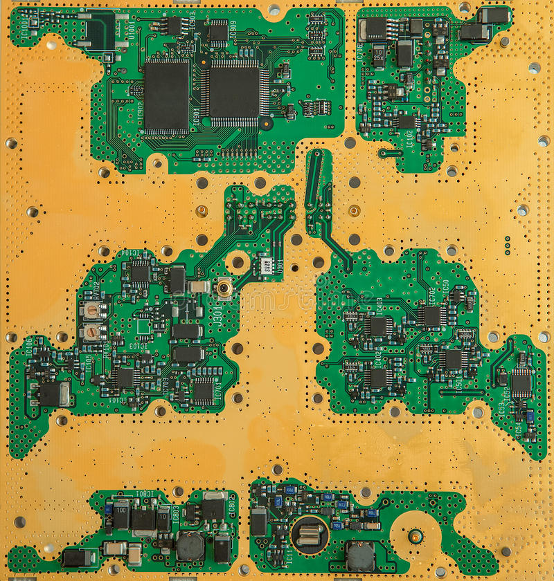 Green Electrical Circuit Board With Conductors And Transistors
