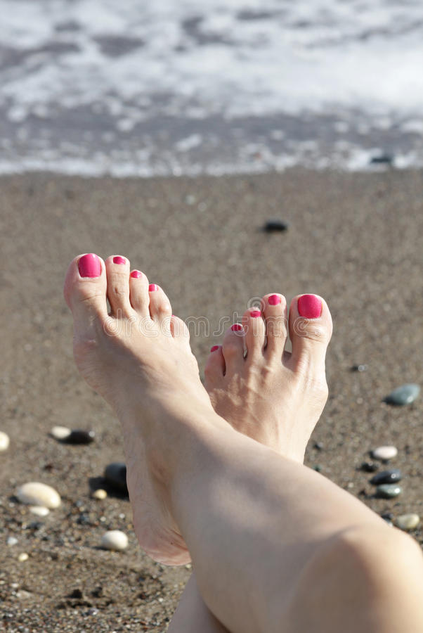Female Feet With Pink Nail Polish By The Sea Stock Image ...