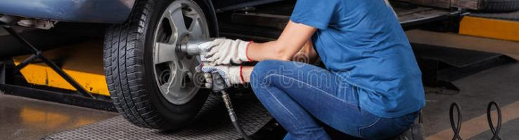 Female Mechanic Fixing Car Tire With Pneumatic Wrench Stock Photo Image Of Problem Automobile