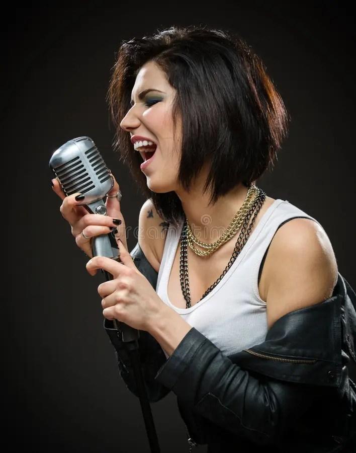 Female Rock Singer Handing Microphone Stock Photo Image