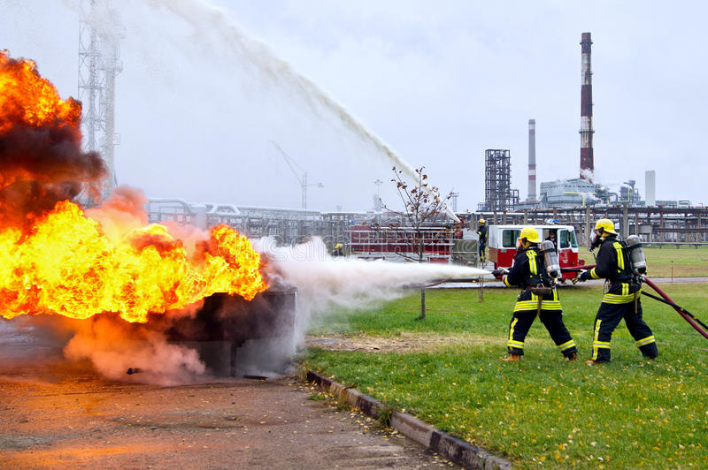 Firefighters Extinguishing Fire Against The Background Of The Re Editorial Stock Image - Image of hose. extinguishing: 45493974