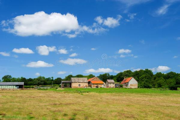 french farmhouse in landscape stock