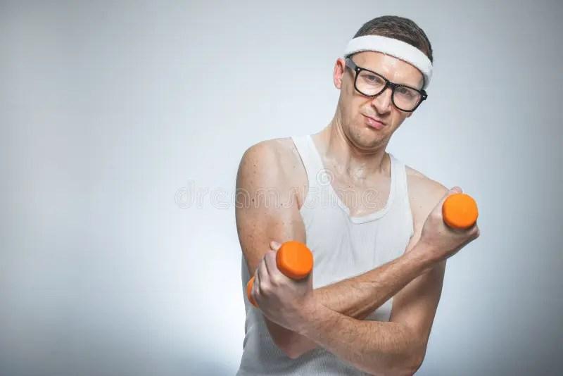 Funny Weak Man Lifting Biceps Stock Photo - Image: 63153238