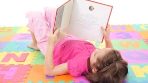 Girl Child Reading Kids Book On Alphabet Royalty Free