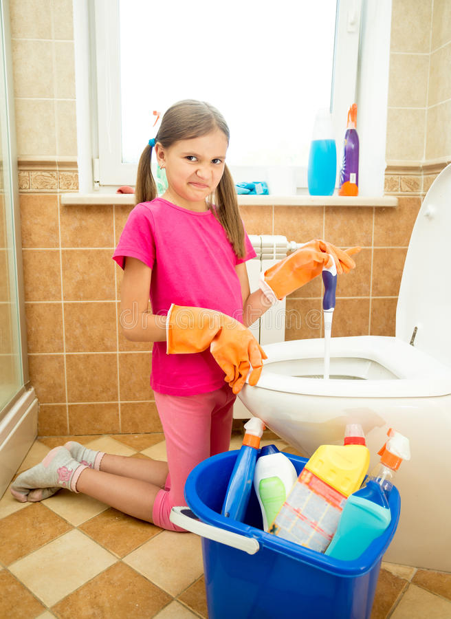Girl Cleaning Toilet With Disgust Stock Photo  Image of