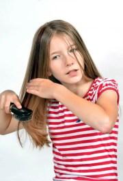 girl hair brush comb stock