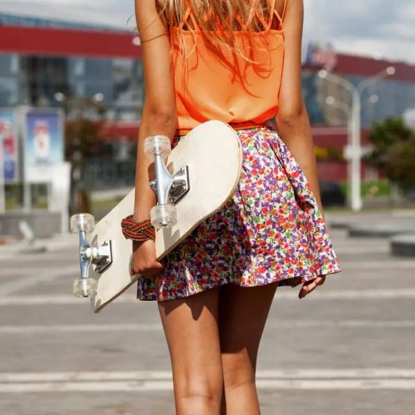 Girl With Skateboard Stock Of Adult Danger