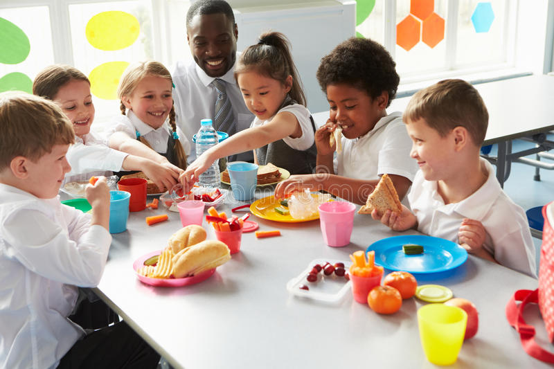 Group Of Children Eating Lunch In School Cafeteria Stock Image - Image of drink. happy: 59777621