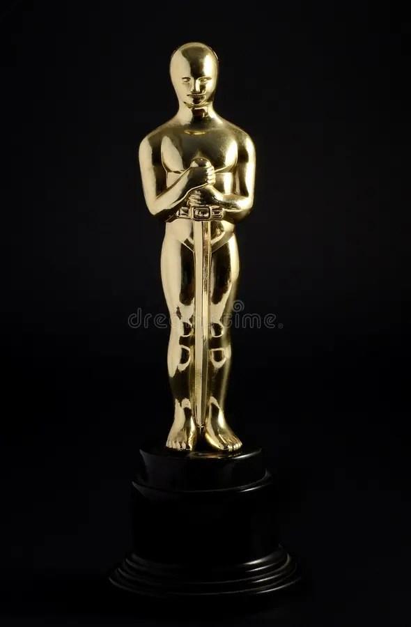 Guld- kopia av en Oscar fotografering för bildbyråer. Bild av statuette - 38809295