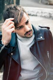 hairstyle young man outdoors. hair