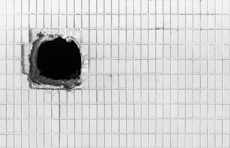 Hole on the old white wall stock photo. Image of pore