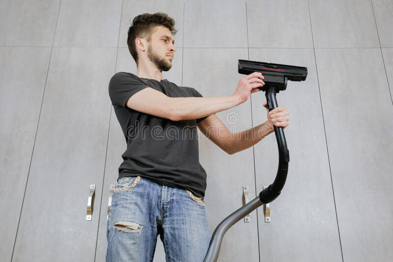 House Cleaning. Man With A Vacuum Cleaner Stock Photo - Image of happy. housing: 184202304