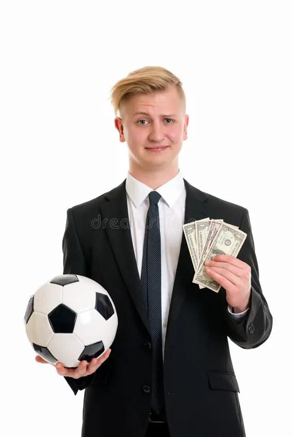 L Argent Dans Le Football : argent, football, Jeune, Homme, D'affaires, Ballon, Football, L'argent, Photo, Stock, Image, Football,, Homme:, 63497562