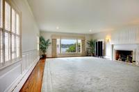 Large Empty Living Room With Fireplace And Lake View ...