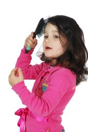 little cute girl brush hair