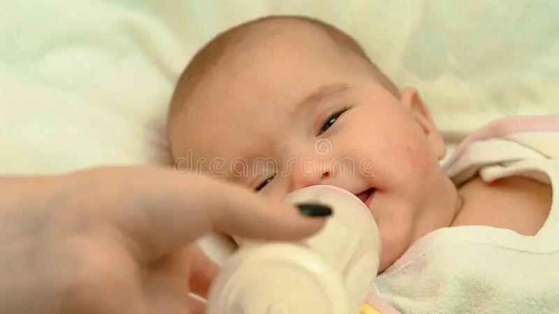 Little Newborn Baby Drinking Milk From A Bottle Stock ...