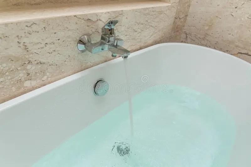 faucet bath tub running water photos