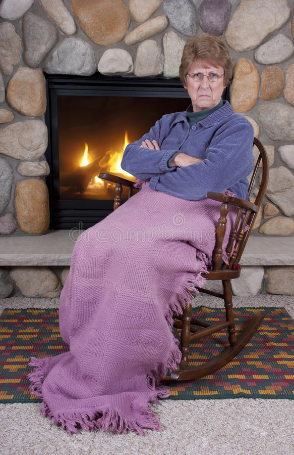 free rocking chair plans rosewood chairs for sale mad angry mature senior woman chair, fire stock image - image: 17623447