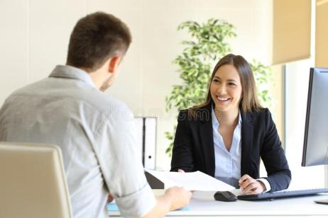 Man giving curriculum in a job interview. Guy giving a curriculum vitae to his interviewer in a job interview stock image