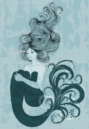 mermaid floating in water stock