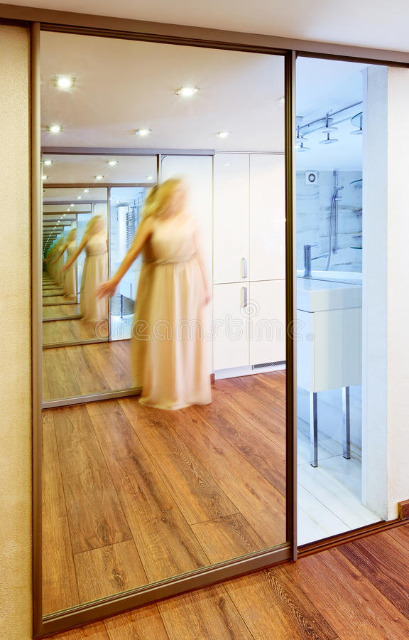 Mirror Wardrobe In Modern Hall Interior With Infinity
