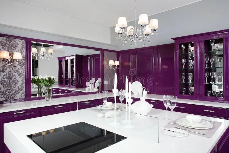 Modern Purple Kitchen With Stylish Furniture Royalty Free