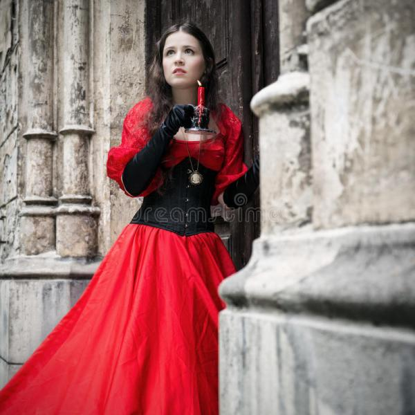Mysterious Woman In Red Victorian Dress Stock