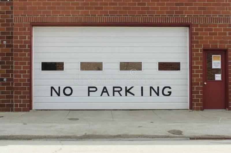 A Garage Door Displays No Parking Sign Royalty Free Stock