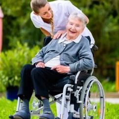 Geriatric Chair For Elderly Ski Plans Nurse Pushing Senior Woman In Wheelchair On Walk Stock Photo - Image Of Chair, Caregiver: 48939254