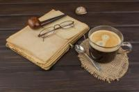 Old Books, Eyewear And Cup Of Coffee On A Dark Wooden ...