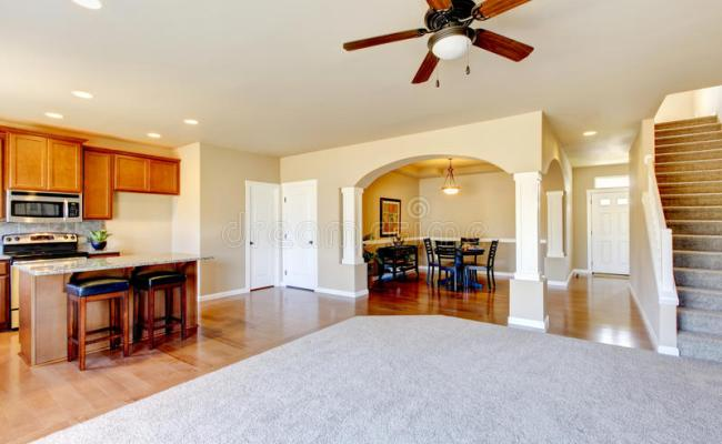 Open Floor Plan View Of Kitchen Dining Room And Entryway
