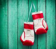 pair of red boxing gloves hanging